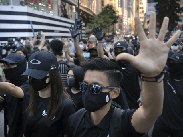Demonstrators wearing masks gather during an anti-government protest in Hong Kong, Saturday, Nov. 2, 2019. Defying a police ban, thousands of black-clad masked protesters are streaming into Hong Kong's central shopping district for another rally demanding autonomy in the Chinese territory as Beijing indicated it could tighten its grip. (AP …
