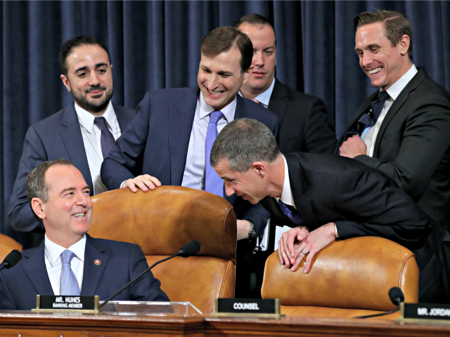 WASHINGTON, DC - NOVEMBER 21: Committee chairman Rep. Adam Schiff (L) (D-CA) jokes with minority counsel Steve Castor (R) and majority counsel Daniel Goldman (3rd L) before Fiona Hill, the National Security Council's former senior director for Europe and Russia, and David Holmes, the under secretary of state for political …
