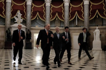 WASHINGTON, DC - FEBRUARY 27: House Majority Whip Rep. Steve Scalise (R-LA), second from left, walks with Deputy Whip Rep. Patrick McHenry (R-NC), at center, on their way to the House chamber to vote on a stopgap spending bill to fund the Department of Homeland Security at the U.S. Capitol …