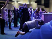 Worshippers pray during a service at the International Church of Las Vegas before the arrival of Republican presidential nominee Donald Trump October 30, 2016 in Las Vegas, Nevada. With nine days to go before Election Day, Trump is hoping to inspire the GOP base, including evangelical Christians, to support him. …