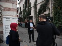 ISTANBUL, TURKEY - NOVEMBER 11: A TV journalist reports from the crime scene in front of the a home and office reportedly belonging to James Le Mesurier, where his body was found dead in the early hours of this morning on November 11, 2019 in the Karakoy district of Istanbul, …