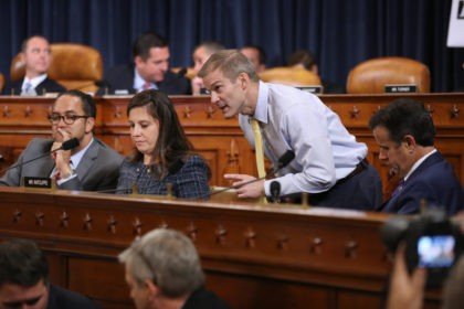 WASHINGTON, DC - NOVEMBER 13: Newly added House Intelligence Committee member Rep. Jim Jordan (R-OH) (3rd L) works to coordinate fellow committee Republicans (L-R) Rep. Will Hurd (R-TX), Rep. Elise Stefanik (R-NY) and Rep. John Ratcliffe (R-TX) during the first day of public hearing in the impeachment inquiry in the …