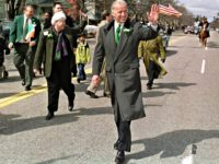 Sen. Joseph Biden, D-Del., center, waves to spectators along the parade route for the St. Patrick's Day Parade in Manchester, N.H., Sunday, March 25, 2001. (AP Photo/Lee Marriner)