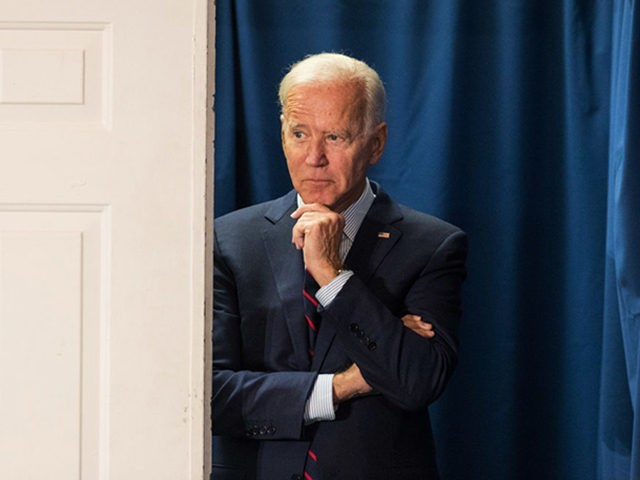 ROCHESTER, NH - OCTOBER 09: Democratic presidential candidate, former Vice President Joe Biden peeks out from backstage during a campaign event on October 9, 2019 in Rochester, New Hampshire. For the first time, Biden has publicly called for President Trump to be impeached. (Photo by Scott Eisen/Getty Images)