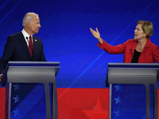 Democratic presidential hopeful Massachusetts Senator Elizabeth Warren (R) speaks as Former Vice President Joe Biden listens during the third Democratic primary debate of the 2020 presidential campaign season hosted by ABC News in partnership with Univision at Texas Southern University in Houston, Texas on September 12, 2019. (Photo by Robyn …