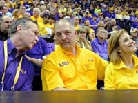 LSU president F. King Alexander, left, chats with Louisiana Gov. John Bel Edwards, center, and Edwards' wife, Donna, during the first half of an NCAA college basketball game between Oklahoma and LSU in Baton Rouge, La., Saturday, Jan. 30, 2016. Oklahoma won 77-75. (AP Photo/Bill Feig)