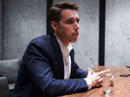 US Republican Senator from Missouri Josh Hawley listens to questions from members of the media at a hotel in Hong Kong on October 14, 2019. - Strife-torn Hong Kong is sliding towards a police state, US senator Josh Hawley warned on October 14, as the financial hub braces for a …