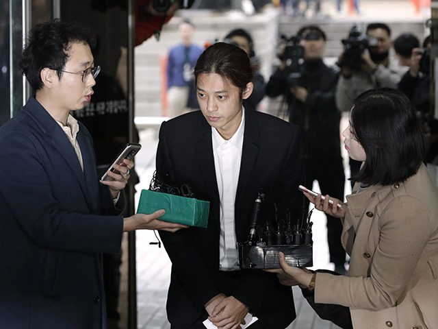 K-pop singer Jung Joon-young is questioned by reporters upon his arrival to attend a hearing at the Seoul Central District Court in Seoul, South Korea, Thursday, March 21, 2019. A South Korean pop star has appeared at a court hearing to decide whether to arrest him over allegations that he …
