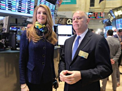 Intercontinentalexchange Chairman and CEO Jeffrey Sprecher, and ICE Vice President of Corporate Affairs Kelly Loeffler visit the floor of the New York Stock Exchange Monday, Nov. 18, 2013. (AP Photo/Richard Drew)