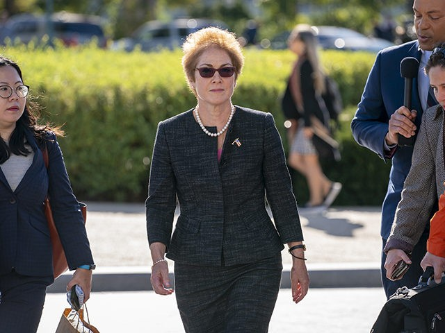FILE - In this Oct. 11, 2019, file photo, former U.S. ambassador to Ukraine Marie Yovanovitch, center, arrives on Capitol Hill, Friday, Oct. 11, 2019, in Washington, to testify before congressional lawmakers as part of the House impeachment inquiry into President Donald Trump. (AP Photo/J. Scott Applewhite, File)