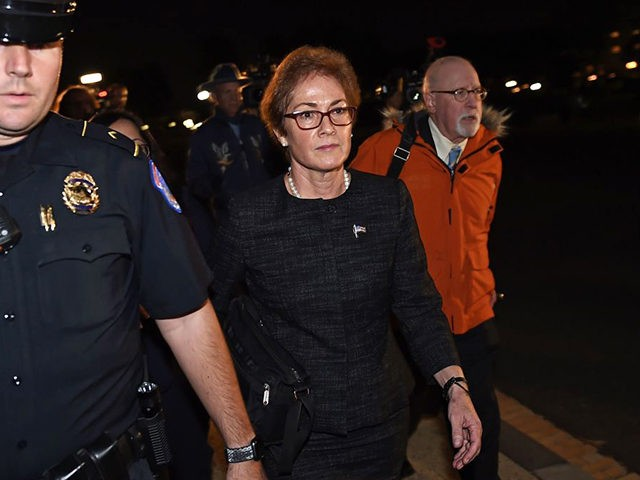 Former US Ambassador to Ukraine Marie Yovanovitch (C) flanked by lawyers, aides and Capitol police, leaves the US Capitol October 11, 2019 in Washington, DC after testifying behind closed doors to the House Intelligence, Foreign Affairs and Oversight committees as part of the ongoing impeachment investigation against President Donald Trump. …