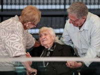 Greek World War II rescuer Melpomeni Dina (C) reacts as she is reunited with holocaust survivors Yossi Mor (R) and his sister Sarah Yanai, whom she helped escape in 1943, at the Hall of Names at the Yad Vashem Holocaust Memorial museum in Jerusalem on November 3, 2019. (Photo by …