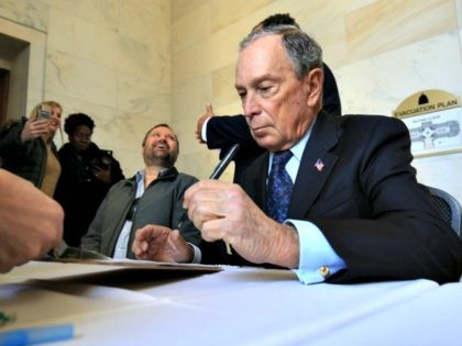 Former New York City Mayor Michael Bloomberg fills out paperwork, Tuesday, Nov. 12, 2019, at the state Capitol in Little Rock, Ark., to appear on the ballot in Arkansas' March 3 presidential primary. Bloomberg hasn't formally announced a bid for the Democratic presidential nomination, but his trip to Arkansas is …