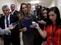WASHINGTON, DC - SEPTEMBER 24: Rep. Mikie Sherrill (C) (D-NJ) is trailed by reporters after leaving a House Democratic caucus meeting at the U.S. Capitol where formal impeachment proceedings against U.S. President Donald Trump were announced by Speaker of the House Nancy Pelosi September 24, 2019 in Washington, DC. Sherrill …