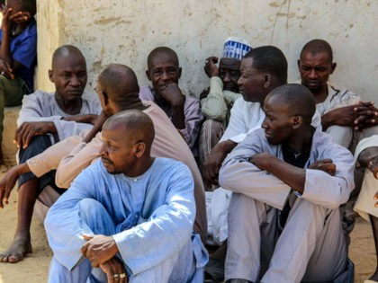 Men gather during a burial ceremony, after two people were killed by Boko Haram fighters in Dalori camp for internally displaced people, near Maiduguri, on July 26, 2019. - Two people were killed and several wounded when Boko Haram fighters raided a camp for people displaced by the jihadist conflict …