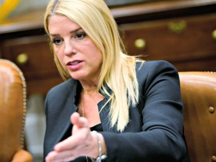Florida Attorney General Pam Bondi speaks during a meeting with US President Donald Trump and state and local officials on school safety in the Roosevelt Room of the White House on February 22, 2018 in Washington, DC. / AFP PHOTO / MANDEL NGAN (Photo credit should read MANDEL NGAN/AFP via …