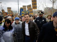 DES MOINES, IA - NOVEMBER 01: Democratic presidential candidate, South Bend, Indiana Mayor Pete Buttigieg (C) walks with his husband Chasten Buttigieg (R) before the Iowa Democratic Party Liberty & Justice Celebration on November 1, 2019 in Des Moines, Iowa. Fourteen presidential are expected to speak at the event addressing …