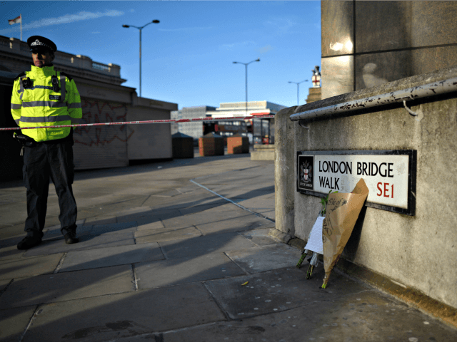 LONDON, ENGLAND - NOVEMBER 30: Flowers rest against a wall at the scene of yesterday's London Bridge stabbing attack on November 30, 2019 in London, England. A man and a woman were killed and three seriously injured in a stabbing attack at London Bridge during which the suspect was shot …