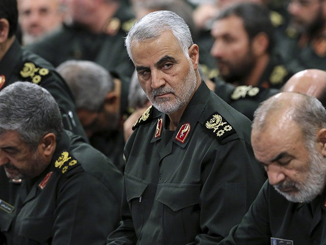 FILE- In this Sept. 18, 2016 file photo released by an official website of the office of the Iranian supreme leader, Revolutionary Guard Gen. Qassem Soleimani, center, attends a meeting in Tehran, Iran. The long shadow war between Israel and Iran has burst into the open in recent days, with …
