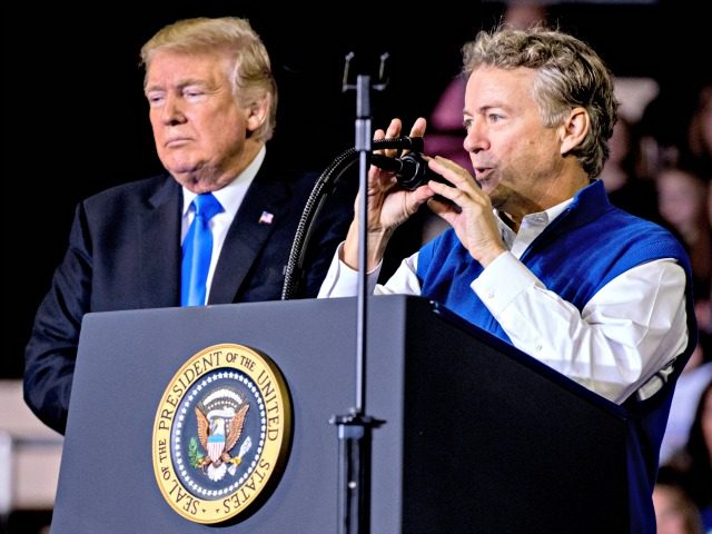 President Donald Trump, left, listens as Sen. Rand Paul, R-Ky., right, speaks at a rally at Alumni Coliseum in Richmond, Ky., Saturday, Oct. 13, 2018. (AP Photo/Andrew Harnik)