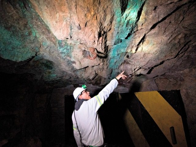 Andree Muntingh, Steenkampskraal (SKK) mine geologist, points to where the monazite reef (darker rock) containing the rare-earth minerals is, underground at the SKK rare-earth mine on July 29, 2019, about 80Km from the Western Cape town of Vanrhynsdorp. - SKK has been confirmed as one of the highest grade deposits …