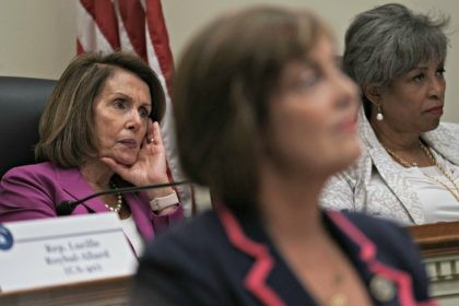 """WASHINGTON, DC - JUNE 21: U.S. House Minority Leader Rep. Nancy Pelosi (D-CA) (L) and Rep. Brenda Lawrence (D-MI) (R) listen during a """"shadow hearing"""" before the Democratic Women's Working Group (DWWG) June 21, 2018 on Capitol Hill in Washington, DC. The hearing addressed immigration and family separation at the …"""