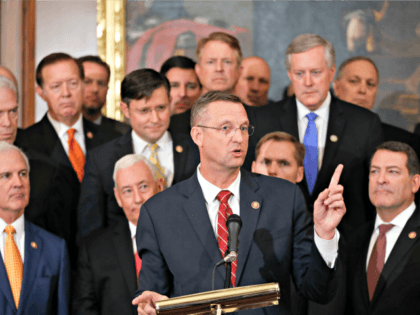 Rep. Doug Collins, R-Ga., center, is joined by fellow Republican lawmakers gestures while speaking during a news conference on Capitol Hill in Washington, Thursday, Oct. 31, 2019. Democrats pushed a package of ground rules for their inquiry of President Donald Trump through a sharply divided House, the chamber's first formal …