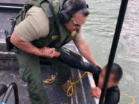 A Laredo Sector Marine Unit agents pulls a Mexican migrant from a creek near the Rio Grande. (Photo: U.S. Border Patrol/Laredo Sector)