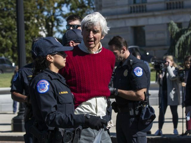 Actor Sam Waterston is arrested by U.S. Capitol Police officers during a rally on Capitol Hill in Washington, Friday, Oct. 18, 2019. (AP Photo/Manuel Balce Ceneta)