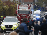 Police escort the truck, that was found to contain a large number of dead bodies, as they move it from an industrial estate in Thurrock, south England, Wednesday Oct. 23, 2019. Police in southeastern England said that 39 people were found dead Wednesday inside a truck container believed to have …