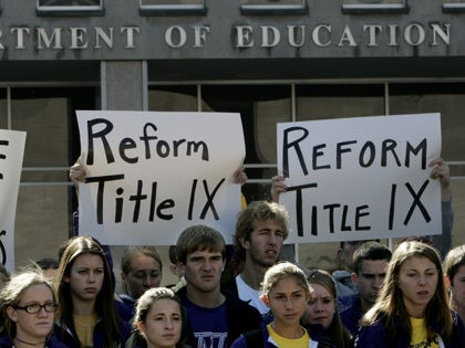 Students from James Madison University take part in a rally outside the Education Department in Washington, Thursday, Nov. 2, 2006. Earlier this year, James Madison announced that it would drop 10 of its athletic teams in order to bring the school into compliance with the federal law demanding equity in …
