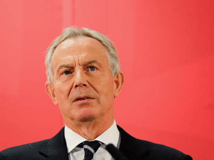 SEDGEFIELD, ENGLAND - APRIL 07: Former British Prime Minister and former Labour MP for Sedgefield, Tony Blair gives a speech to waiting party members ahead of a visit to the construction site for the new Hitachi Trains Europe factory on April 7, 2015 in Sedgefield, England. The visit came as …