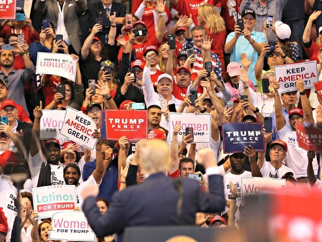 SUNRISE, FLORIDA - NOVEMBER 26: People cheer as they listen to U.S. President Donald Trump speak during a homecoming campaign rally at the BB&T Center on November 26, 2019 in Sunrise, Florida. President Trump continues to campaign for re-election in the 2020 presidential race. (Photo by Joe Raedle/Getty Images)