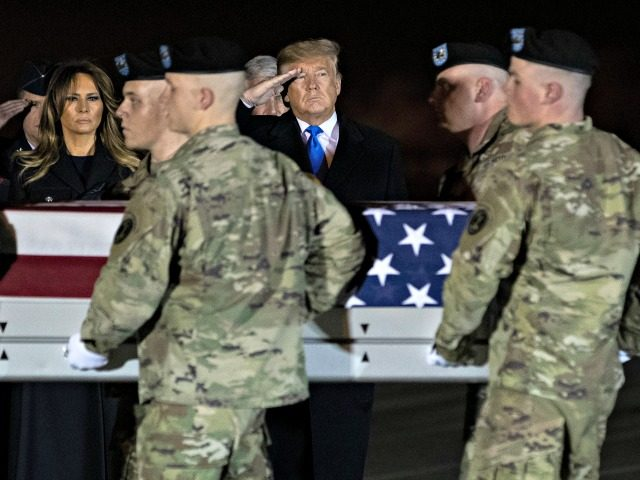 President Donald Trump and first lady Melania Trump look on as a U.S. Army carry team moves a transfer case containing the remains of Chief Warrant Officer 2 David C. Knadle, of Tarrant, Texas, who according to the Department of Defense died in Afghanistan, during a casualty return ceremony, Thursday, …