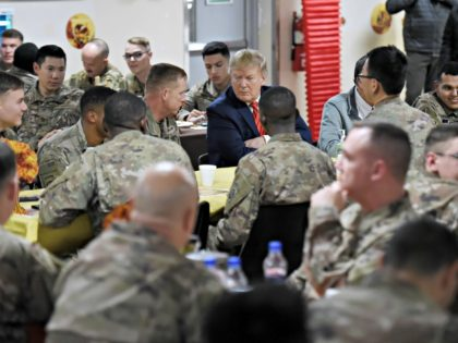 US President Donald Trump shares a Thanksgiving dinner with US troops at Bagram Air Field during a surprise visit on November 28, 2019 in Afghanistan. (Photo by Olivier Douliery / AFP) (Photo by OLIVIER DOULIERY/AFP via Getty Images)