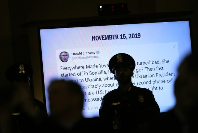 WASHINGTON, DC - NOVEMBER 15: A tweet from U.S. President Donald Trump created while former U.S. Ambassador to Ukraine Marie Yovanovitch's testifies before the House Intelligence Committee is shown in the Longworth House Office Building on Capitol Hill November 15, 2019 in Washington, DC. In the second impeachment hearing held …
