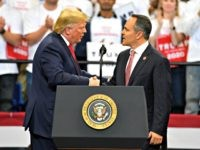 President Donald Trump, left, shakes hands with Kentucky Gov. Matt Bevin during a campaign rally in Lexington, Ky., Monday, Nov. 4, 2019. (AP Photo/Timothy D. Easley)