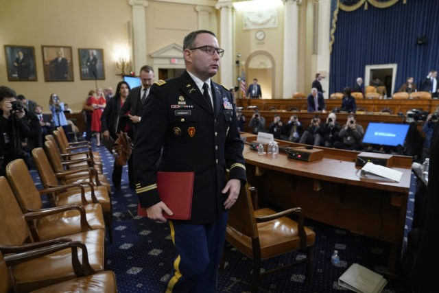 WASHINGTON, DC - NOVEMBER 19: Lt. Col. Alexander Vindman, National Security Council Director for European Affairs, departs after testifying before the House Intelligence Committee in the Longworth House Office Building on Capitol Hill November 19, 2019 in Washington, DC. The committee heard testimony during the third day of open hearings …