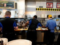 Cooks at Waffle House prepare food at a Waffle House Restaurant on September 13, 2018 in Conway, South Carolina. - Hurricane Florence edged closer to the east coast of the US Thursday, with tropical-force winds and rain already lashing barrier islands just off the North Carolina mainland. The huge storm …