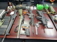CBP officers seized several firearms as well as nearly 2,000 rounds of ammo inside of a smuggling vehicle. (Photo: U.S. Customs and Border Protection/Tucson Sector)