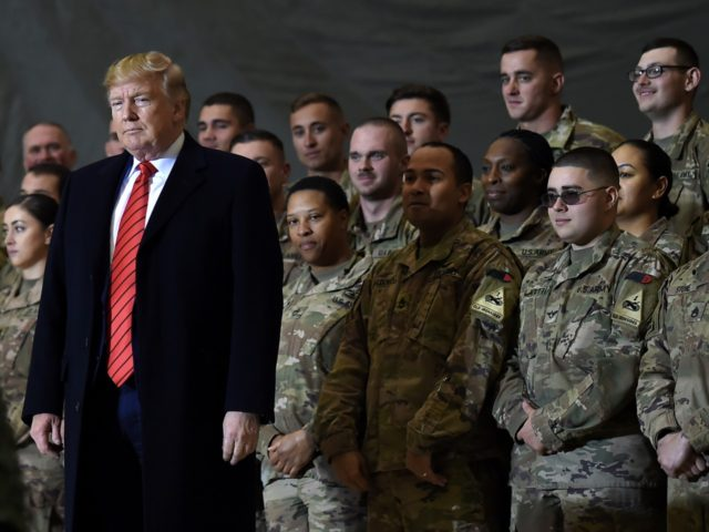 US President Donald Trump speaks to the troops during a surprise Thanksgiving day visit at Bagram Air Field, on November 28, 2019 in Afghanistan. (Photo by Olivier Douliery / AFP) (Photo by OLIVIER DOULIERY/AFP via Getty Images)