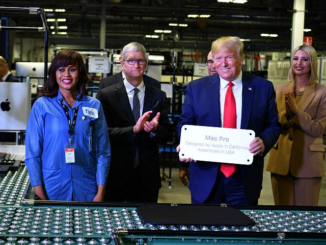 US President Donald Trump (2nd R) and Apple CEO Tim Cook (2nd L), with Senior Advisor to the President Ivanka Trump (R), tour the Flextronics computer manufacturing facility where Apple's Mac Pros are assembled in Austin, Texas, on November 20, 2019. (Photo by MANDEL NGAN / AFP) (Photo by MANDEL …