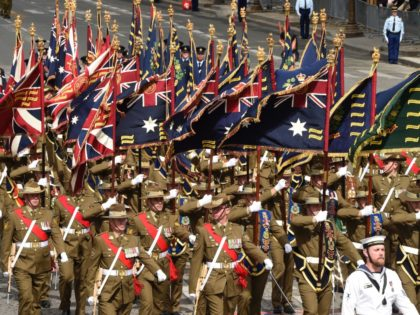 Troops from Australia and New-Zealand arrive Place de la Concorde as they take part in the annual Bastille Day military parade on the Champs-Elysees avenue in Paris on July 14, 2016. France holds annual Bastille Day military parade with troops from Australia and New Zealand as special guests among the …