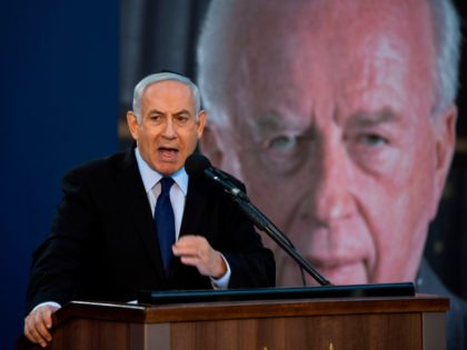 Israeli Prime Minister Benjamin Netanyahu speaks during a state memorial ceremony for former Israeli prime minister Yitzhak Rabin (backround) and his wife Leah, at Mount Herzl in Jerusalem on November 10, 2019. (Photo by HEIDI LEVINE / POOL / AFP) (Photo by HEIDI LEVINE/POOL/AFP via Getty Images)