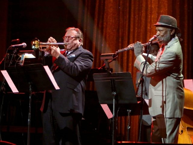 HOLLYWOOD, CA - NOVEMBER 15: Arturo Sandoval (L) and Hubert Laws perform onstage during the Thelonious Monk Institute International Jazz Vocals Competition 2015 at Dolby Theatre on November 15, 2015 in Hollywood, California. (Photo by Rachel Murray/Getty Images for Thelonious Monk Institute of Jazz)