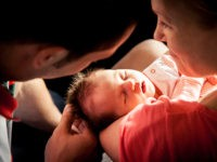 Newborn baby on mother hands - stock photo