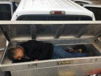 Bordrer Patrol agents find a Mexican migrant locked in a pickup truck's toolbox. (Photo: U.S. Border Patrol/Del Rio Sector)