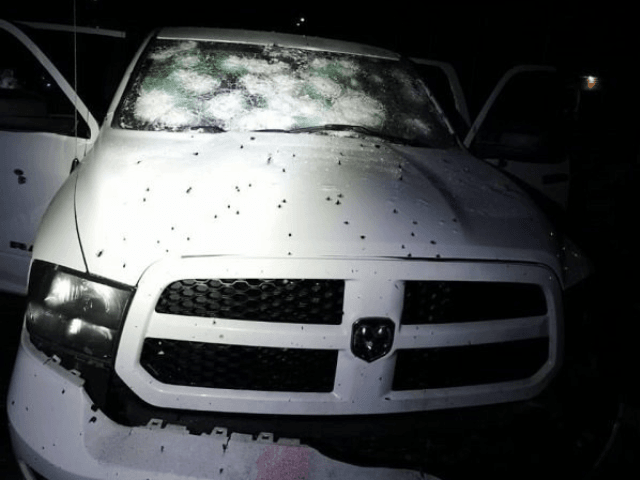 A police vehicle riddled with hundreds of rounds of gunfire in central Mexico. (Police photo)