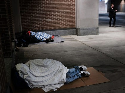 PHILADELPHIA, PA - OCTOBER 18: Homeless people sleep on a sidewalk on October 18, 2018 in Philadelphia, Pennsylvania. Recent data released by the U.S. Census Bureau shows that Philadelphia's poverty rate remains at roughly 26 percent, making it the poorest of the nation's 10 major cities. While sections of the …