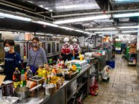 A team including Poly U management, security guards, councillors and the Hong Kong Red Cross walk through a canteen kitchen in search of any remaining protesters hiding at the Hong Kong Polytechnic University in the Hung Hom district of Hong Kong on November 26, 2019, over a week after police …